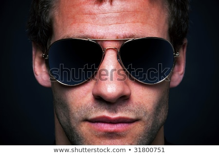 sorridente · homem · óculos · de · sol · imagem · jovem - foto stock © rtimages