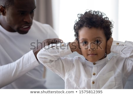 Wymagający młody chłopak patrząc kamery cute co Zdjęcia stock © ozgur