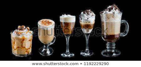 Irlandés crema café granos de café mesa vidrio Foto stock © netkov1