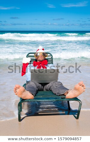 businessman with a santa hat relaxing in his office chair Stock photo © nito