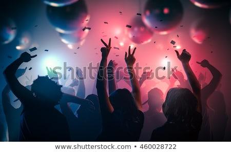 happy young women dancing at night club disco Stock photo © dolgachov