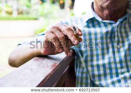 old man smoking stock photo © zurijeta