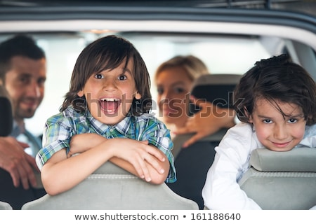 playful kids in the back of a car stock photo © zurijeta