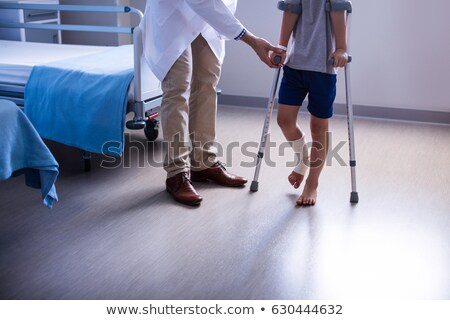 A boy with a fractured leg Stock photo © bluering