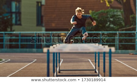 Man runner doing hurdles running Stock photo © bluering