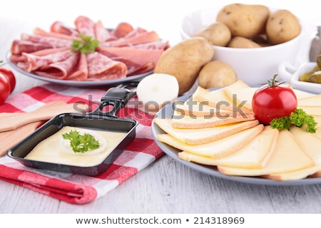 raclette cheese with meats and potato Stock photo © M-studio