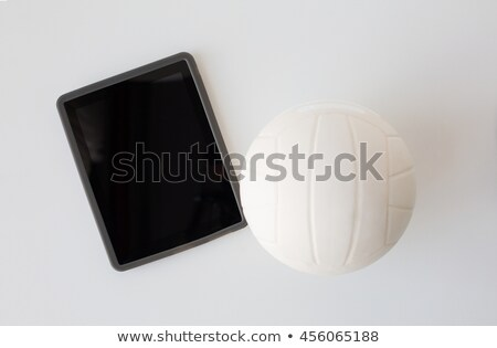 close up of volleyball ball and tablet pc computer Stock photo © dolgachov