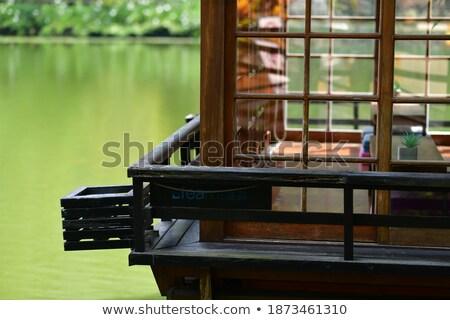 деревянный стул поверхность пруд закат небе воды Сток-фото © CaptureLight