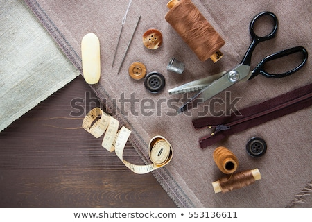 Foto stock: Set Scissor Buttons Zip Tape Measure Thread And Thimble On