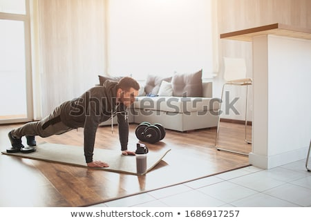 Sporty man doing plank position Stock photo © LightFieldStudios