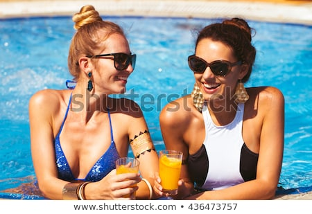 Happy girls with beverages on summer party near the pool, summer Stock photo © Yatsenko