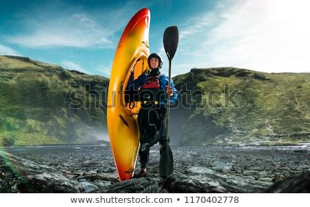 Foto stock: Ombre · en · kayak · en · rápidos
