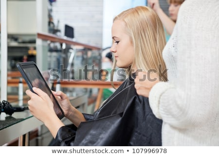 young woman in parlour with tablet stock photo © dash