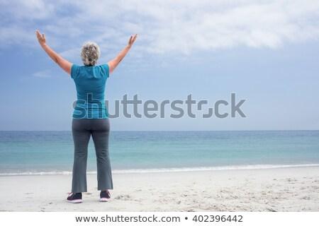 Teljes alakos idős nő karok a magasban homok tengerpart Stock fotó © wavebreak_media
