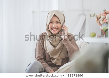 Young muslim business woman laughing. Stock photo © RAStudio