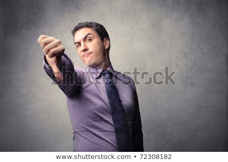 Disappointed caucasian businessman with thumb down Stock photo © RAStudio