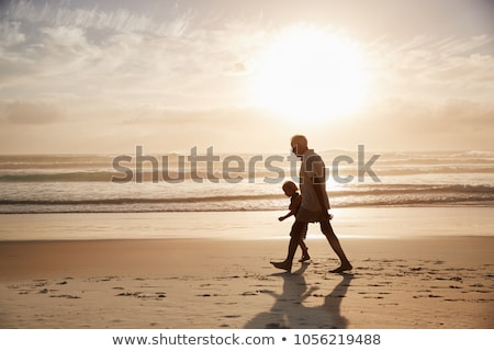 Grandfather and grandson on the beach Stock photo © IS2