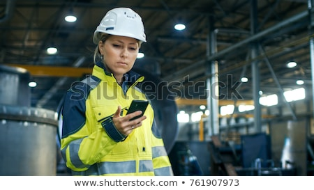 woman on mobile in workshop Stock photo © IS2