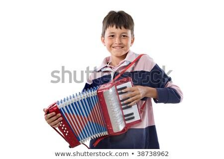 Kaukasisch jongen spelen accordeon glimlachend Stockfoto © RAStudio