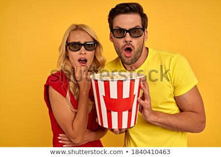 Young woman with cola afraid of film isolated Stock photo © deandrobot