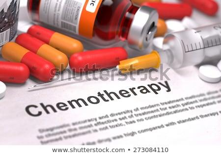 cancer treatment   medical concept on orange background stock photo © tashatuvango