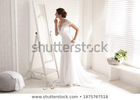 glimlachend · bruid · poseren · witte · jurk · geïsoleerd - stockfoto © dashapetrenko