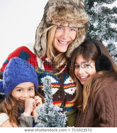 Mother and daughters beside snowy trees Stock photo © IS2