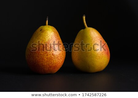 Close up of a fresh pear isolated over black Stock photo © deandrobot