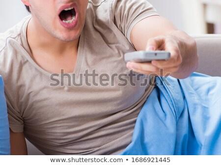 男 を見て テレビ ベッド リモコン ストックフォト © Elnur