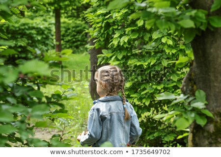 Young girl hiding behind tree Stock photo © IS2