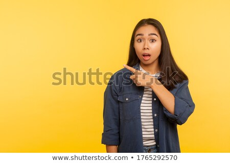 Woman pointing fingers left and right Stock photo © studiostoks