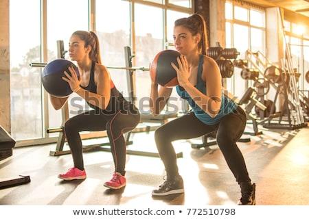 Sportos lányok képzés tornaterem szürke nők Stock fotó © bezikus