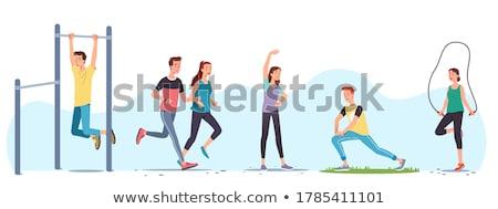 sportive couple doing workout in outdoor gym stock photo © kzenon