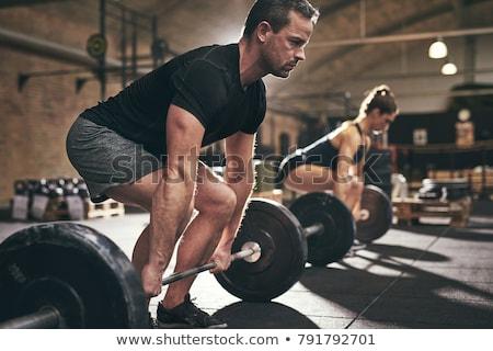 Sportos férfi súlyemelés illusztráció izmos férfi Stock fotó © lenm