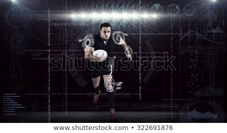 Composite image of athlete running with rugby ball Stock photo © wavebreak_media