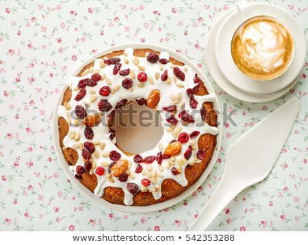 Delicious pastry with raisins and a cup of coffee top view. Stock photo © dash