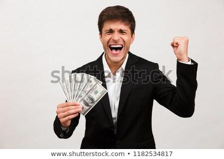 feliz · empresário · em · pé · isolado · dinheiro - foto stock © deandrobot