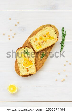 Bowl of hummus with toasts Stock photo © Alex9500