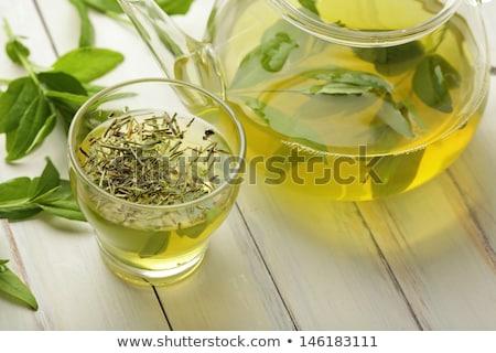 Szárított növénygyűjtemény zöld tea felső kilátás űr háttér Stock fotó © karandaev