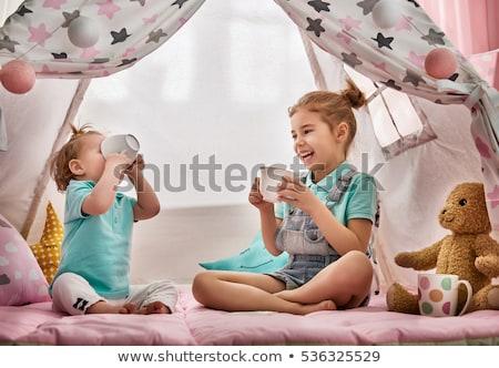 Kislány játszik tea buli gyerekek sátor Stock fotó © dolgachov