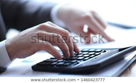 üzletember · pénzügy · iroda · boldog · érett · számológép - stock fotó © snowing
