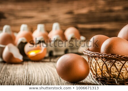Hen eggs in wooden box Stock photo © karandaev
