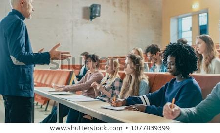 College studenten luisteren hoogleraar gehoorzaal vrouw Stockfoto © artisticco