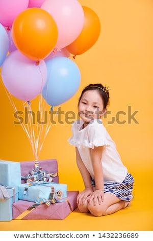 Aranyos kislány ázsiai származású néz pózol kamera Stock fotó © pressmaster