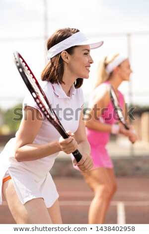 Young successful female tennis player and her teammate Stock photo © pressmaster