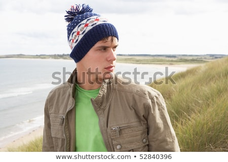 Teenage Boy Standing In Sand Dunes Wearing Woolly Hat Stock photo © monkey_business