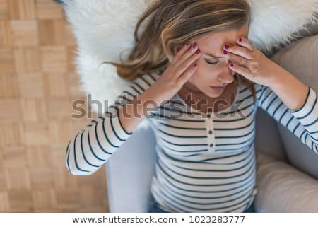 Nő beteg fekszik ágy szomorú hotel Stock fotó © Lopolo