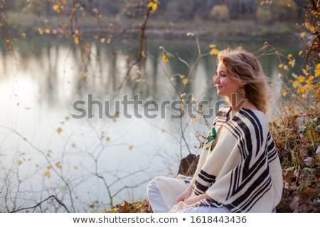 Pensive woman in autumn park near river Stock photo © dariazu