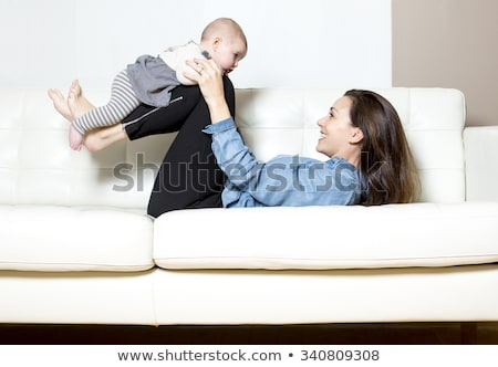 mother with baby on the sofa taking good time stock photo © lopolo