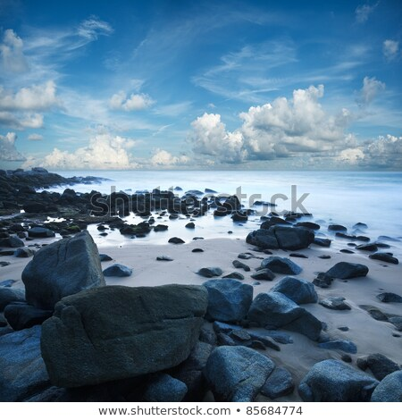 view of a rocky seacoast long exposure shot stock photo © moses